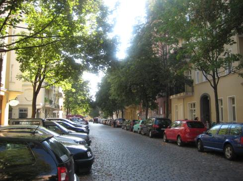 A view of the quiet Esmarchstraße on a sunny afternoon.